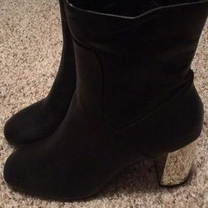 Black boots with gold heel